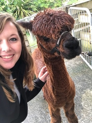 New Zealand student poses with a lama